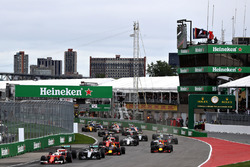 Sebastian Vettel, Ferrari SF16-H leads Nico Rosberg, Mercedes AMG F1 W07, Lewis Hamilton, Mercedes AMG F1 W07, Daniel Ricciardo, Red Bull Racing RB12, Max Verstappen, Red Bull Racing RB12 and the rest of the field at the start