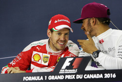 (L to R): Sebastian Vettel, Ferrari and Lewis Hamilton, Mercedes AMG F1 in the FIA Press Conference
