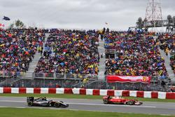 Kimi Raikkonen, Ferrari SF16-H leads Nico Hulkenberg, Sahara Force India F1 VJM09