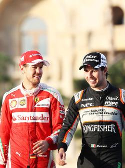 (L to R): Sebastian Vettel, Ferrari with Sergio Perez, Sahara Force India F1