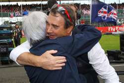 Bernie Ecclestone, with Nigel Mansell, FIA Steward on the grid
