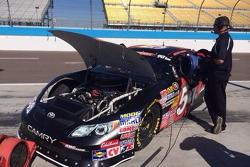 Monitoring Anthony Giannone's #54 K&N West ride during a break in practice at Phoenix