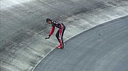 Kurt Busch walks on track to check temperature, grip
