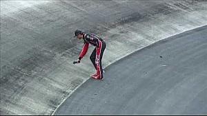 Kurt Busch walks on track to check temperature, grip